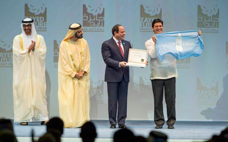 Sheikh Mohammed bin Rashid, Gen. Mohamed bin Zayed and Abdel Fattah El Sisi, President of Egypt, present the Zayed Future Energy Prize Non-Profit Organisation Award to Illac Diaz, Executive Director of Liter of Light, in Abu Dhabi on Monday. (Wam)