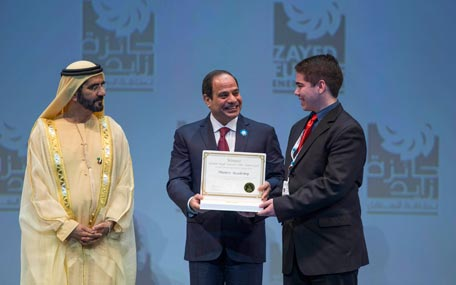 Sheikh Mohammed bin Rashid and Abdel Fattah El Sisi, President of Egypt, present the Zayed Future Energy Prize Americas Global High Schools Award to a student representative from Munro Academy in Canada. (Wam)