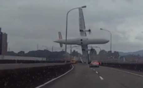 Amateur dramatic dashcam images showed the ill-fated plane hitting an elevated road as it banked steeply away from buildings before crashing into the Keeling River. (Reuters)