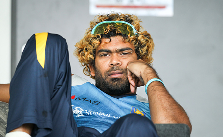 Lasith Malinga of Sri Lanka sits in the dressing room during the One Day International match between New Zealand and Sri Lanka at Hagley Oval on January 11, 2015 in Christchurch, New Zealand. (Getty)