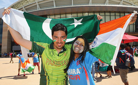 Pakistan and India supporters pose with their flags outside of the ground during the 2015 ICC Cricket World Cup match between India and Pakistan at the Adelaide Oval on February 15, 2015 in Adelaide, Australia. (Getty Images)
