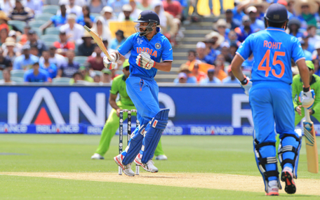India's Shikhar Dhawan, center, watches a shot during the World Cup Pool B match between India and Pakistan in Adelaide, Australia, Sunday, Feb. 15, 2015. (AP)