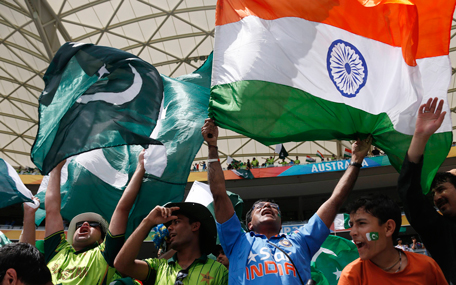 Fans of Pakistan's cricket team (L) and India's (R) cheer in the stands before Pakistan's Cricket World Cup match against India in Adelaide, February 15, 2015.  (REUTERS)