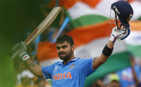 India's batsman Virat Kohli acknowledges the crowd upon scoring a century during their Cricket World Cup match against Pakistan in Adelaide, February 15, 2015.  (Reuters)