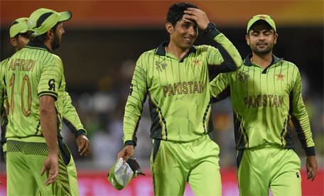 Pakistan cricketers (from left) Haris Sohail, Shahid Afridi, Misbah-ul Haq and Ahmad Shehzad walk back after winning the 2015 Cricket World Cup Pool B match between Pakistan and Zimbabwe at the Gabba Stadium in Brisbane on March 1, 2015.  (AFP)