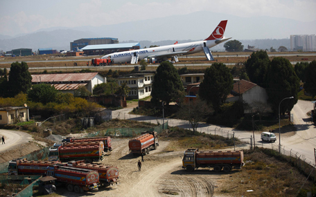 A Turkish Airlines plane lies on the field after it overshot the runway at Tribhuvan International Airport in Kathmandu March 4, 2015. According to local media, all passengers were rescued. REUTERS