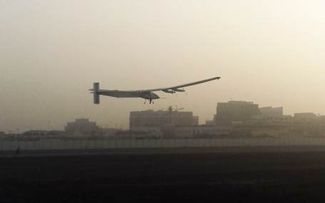 A Swiss solar-powered plane takes off at an airport in Abu Dhabi, United Arab Emirates, early Monday, March 9, 2015, marking the start of the first attempt to fly around the world without a drop of fuel. Solar Impulse founder Andre Borschberg was at the controls of the single-seater when it took off from the Al Bateen Executive Airport. Borschberg will trade off piloting with Solar Impulse co-founder Bertrand Piccard during stop-overs on a journey that will take months to complete. (AP)