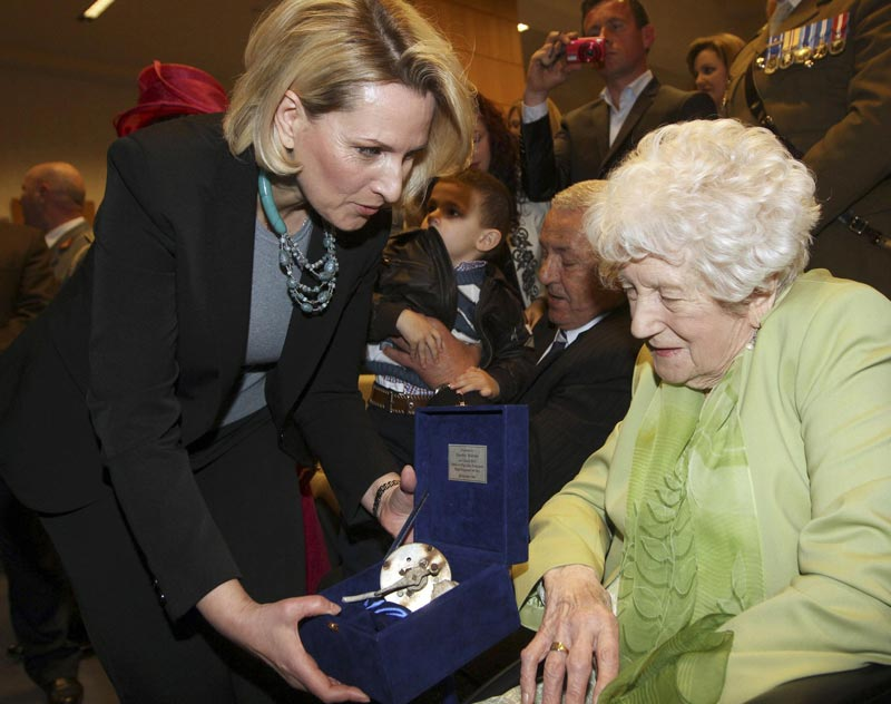Albania's Defence Minister Mimi Kodheli (left) hands Dorothy Webster, 92, the sister of British flight engineer Sergeant John Thompson, a box containing the remains of his Halifax bomber during a ceremony held at the Ministry of Defence in Tirana March 9, 2015. (Reuters)