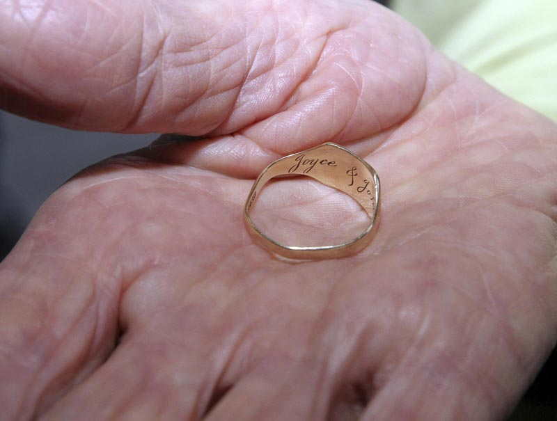 Dorothy Webster, the sister of the British flight engineer Sergeant John Thompson, holds his wedding ring after it was handed back to her during a ceremony held at the Ministry of Defence, in Tirana March 9, 2015. (Reuters)