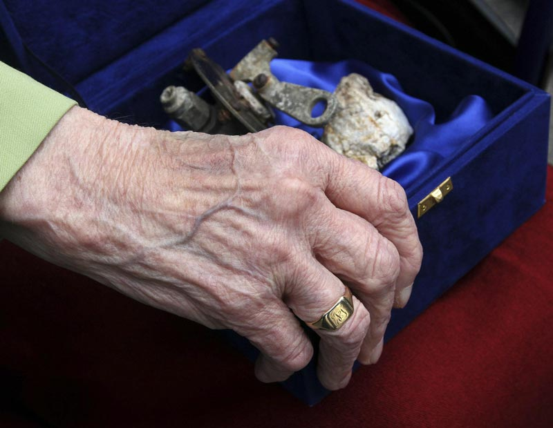 Dorothy Webster, 92, the sister of British flight engineer Sergeant John Thompson, wears his wedding ring and holds a box containing the remains of his Halifax bomber during a ceremony held at the Ministry of Defence in Tirana March 9, 2015. (Reuters)