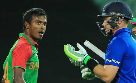 Bangladesh'S bowler Rubel Hossain (L) looks at England's batsman Ian Bell (R) after he was caught behind by wicket keeper Mushfiqur Rahim during their Cricket World Cup match in Adelaide March 9, 2015. (Reuters)
