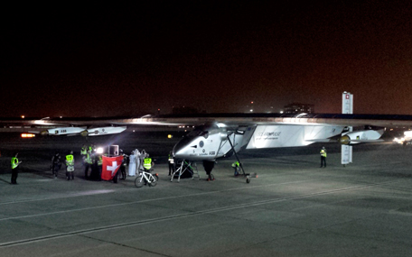 The Solar Impulse 2 prepares to depart at an airport in Abu Dhabi, United Arab Emirates, early Monday, March 9, 2015. The Swiss solar-powered plane took off from Abu Dhabi early Monday, marking the start of the first attempt to fly around the world without a drop of fuel. (AP)