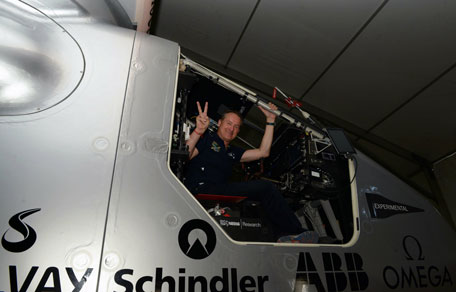 Swiss pilot Andre Borschberg, co-founder and CEO behind Solar Impulse 2, the world's only solar powered aircraft, poses for a photograph inside the cockpit of the plane at Sardar Vallabhbhai Patel International Airport in Ahmedabad on March 17, 2015. (AFP)