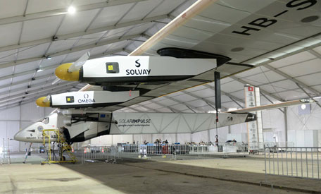 A support team member works on Solar Impulse 2, the world's only solar powered aircraft, at Sardar Vallabhbhai Patel International Airport in the Indian city of Ahmedabad on March 17, 2015. (AFP)