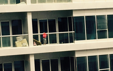A child, who appears to be not more than five-years-old, is seen throwing a toy over the balcony ledge, before pulling himself up to hang on the edge. [PIX: Jyothi Ferrao on Facebook]