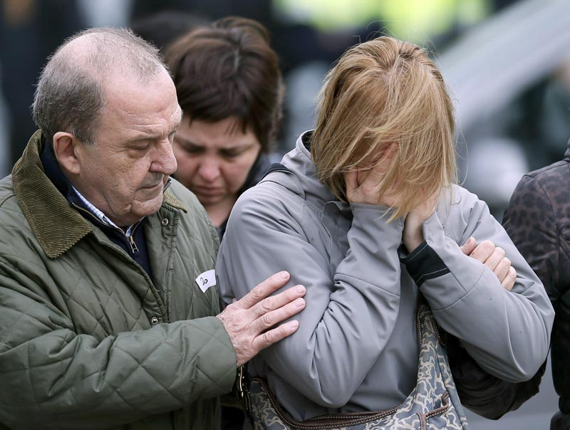 Family members of passengers feared killed in Germanwings plane crash react at Barcelona's El Prat airport on Tuesday March 24, 2015. (Reuters)