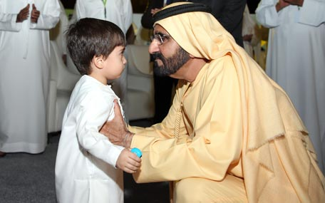 Sheikh Mohammed bin Rashid Al Maktoum meets a young visitor during a of the International Emergency and Catastrophe Management Conference and Exhibition (IECM) and the Dubai International Humanitarian Aid & Development Exhibition, in Dubai on Wednesday. (Wam)