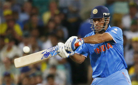 India's MS Dhoni hits the ball for four runs during his Cricket World Cup semi-final match against Australia in Sydney, March 26, 2015. (Reuters)