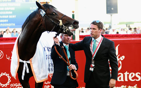Former England international footballer Michael Owen and trainer Tom Dascombe pose with Brown Pather after winning Dubai Gold Cup during the Dubai World Cup at the Meydan Racecourse on March 28, 2015 in Dubai, UAE. (Getty)