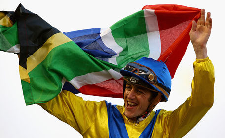Christophe Soumillon celebrates after winning the UAE Derby during the Dubai World Cup at the Meydan Racecourse on March 28, 2015 in Dubai, UAE. (Getty Images)