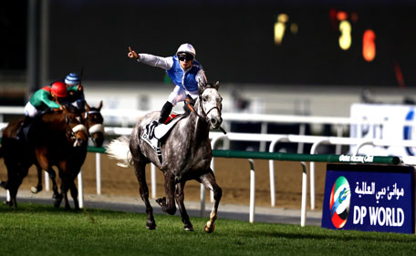 Maxime Guyon celebrates riding Solow to victory in the Dubai Turf during the Dubai World Cup at the Meydan Racecourse on March 28, 2015 in Dubai, UAE. (Getty Images)