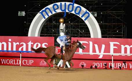 William Buick celebrates riding Prince Bishop to victory in the Dubai World Cup at the Meydan Racecourse on March 28, 2015 in Dubai, UAE. (Getty Images)