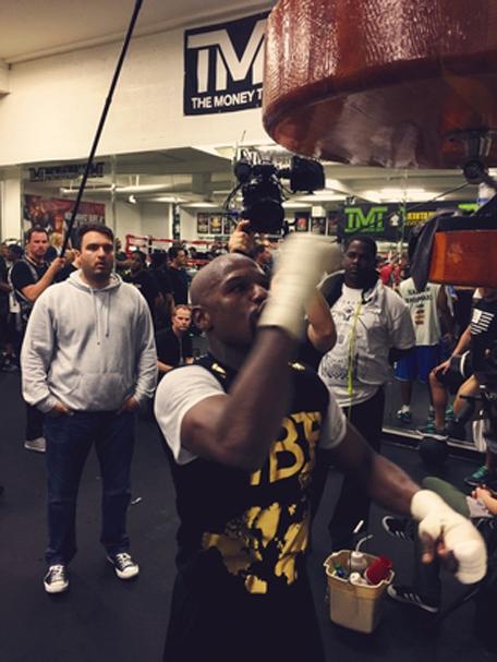 Floyd Mayweather gets the punch on. (shots.com/floydmayweather)