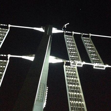 Alain Robert climbing the Cayan Tower on Sunday in Dubai. (Pic: Alain Robert @ Facebook)