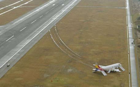 Asiana Airlines airplane which ran out of the runway after landing at Hiroshima airport in Mihara, Hiroshima prefecture, western Japan, in this photo taken by Kyodo. (Reuters)