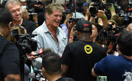 Actor David Hasselhoff greets WBC/WBA welterweight champion Floyd Mayweather Jr as he conducts interviews before working out at the Mayweather Boxing Club on April 14, 2015 in Las Vegas, Nevada. (AFP)