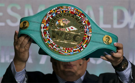 Mauricio Sulaiman, president of the World Boxing Council, holds up the 'Cinturon Esmeralda' or Emerald Belt, during a media presentation, in Mexico City, Tuesday, April 21, 2015. (AP)