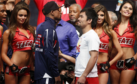 Floyd Mayweather (centre left) and Manny Pacquiao (centre right) face off following their weigh-in on May 1, 2015 in Las Vegas, Nevada one day before their 'Fight of the Century' on May 2 at the MGM Grand Garden Arena. (AFP)