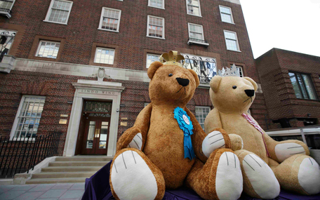Two giant teddy bears are driven past during a PR stunt outside the Lindo wing of St Mary's Hospital in central London, May 1, 2015. Britain's Katherine, Duchess of Cambridge is due to give birth to her second child at the hospital in the next few days. (REUTERS)