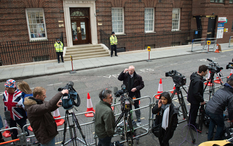 Media teams rush to get their positions in the press pens outside the Lindo wing at St Mary's hospital in central London, on May 2, 2015 after the announcement was made by Kensington Palace that the Duchess of Cambridge, Prince William's wife Kate was admitted to hospital on May 2 in the early stages of labour with her second child. (AFP)