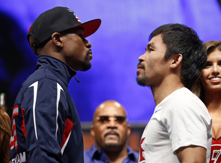 Floyd Mayweather Jr., left, and Manny Pacquiao pose during their weigh-in on Friday, May 1, 2015 in Las Vegas. The world weltherweight title fight between Mayweather Jr. and Pacquiao is scheduled for May 2. (AP)