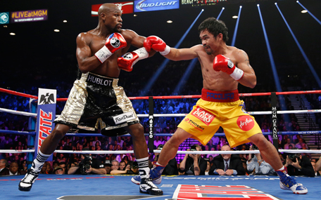 Manny Pacquiao, right, from the Philippines, trades blows with Floyd Mayweather Jr., during their welterweight title fight on Saturday, May 2, 2015 in Las Vegas.  (AP)