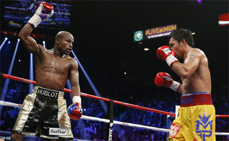 Floyd Mayweather Jr (left) celebrates during his welterweight title fight against Manny Pacquiao, from the Philippines, on Saturday, May 2, 2015 in Las Vegas. (AP)