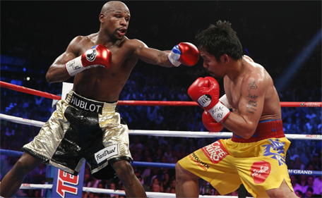 US boxer Floyd Mayweather Jr (left) and Manny Pacquiao of the Philippines fight during their welterweight unification boxing bout at the MGM Grand Garden Arena in Las Vegas, Nevada on May 2, 2015. (AFP)
