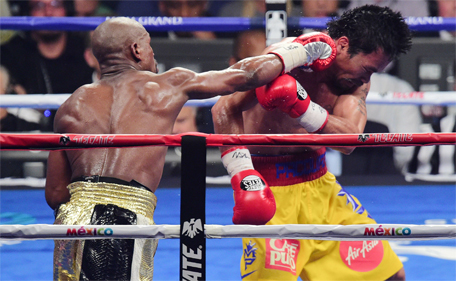 Floyd Mayweather Jr of the US goes after Manny Pacquiao (left) of the Philippines during their welterweight WBO, WBC and WBA (Super) title fight in Las Vegas, Nevada, May 2, 2015. (Joe Camporeale-USA TODAY Sports)