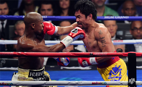 Floyd Mayweather and Manny Pacquiao box during their world welterweight championship bout at MGM Grand Garden Arena. (Joe Camporeale-USA TODAY Sports)