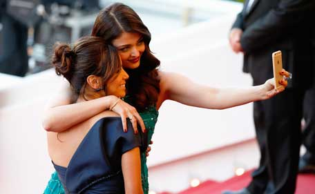 Actresses Eva Longoria and Aishwarya Rai pose for a selfie at the Premiere of 'Carol' during the 68th annual Cannes Film Festival on May 17, 2015 in Cannes, France. (Getty images)