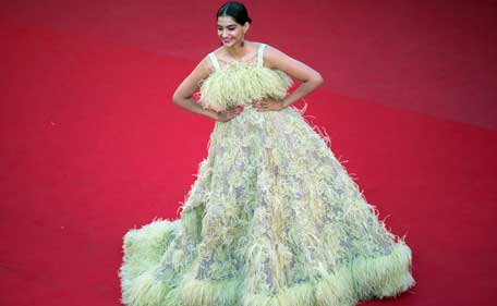 Indian actress Sonam Kapoor poses as she arrives for the screening of the film 'Inside Out' at the 68th Cannes Film Festival in Cannes, southeastern France, on May 18, 2015. (AFP)