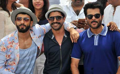 Indian Bollywood actors (L/R) Ranveer Singh, Farhan Akhtar and Anil Kapoor pose during a special brunch and promotion for the forthcoming Hindi film 'Dil Dhadakne Do' directed by Zoya Akhtar in Mumbai on May 3, 2015. (AFP)