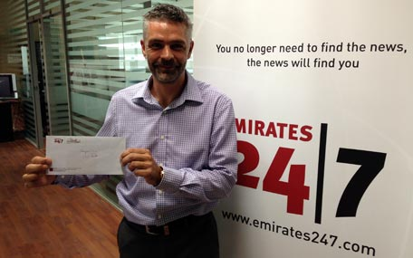 Carl Hardie after receiving the Emirates 24|7 cash prize on Monday. (Picture by Mohammed Feroz Khan)