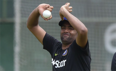 Indian cricketer Ravichandran Ashwin delivers a ball during a practice session at the Sher-e-Bangla National Cricket Stadium in Dhaka on June 17, 2015, ahead of the first ODI cricket match against Bangladesh. (AFP)