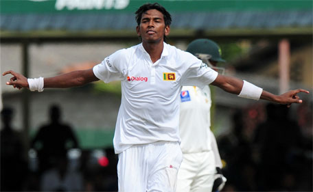 Sri Lankan bowler Dushmantha Chameera celebrates the wicket of Pakistan batsman Junaid Khan during the fourth day of the second Test match between Sri Lanka and Pakistan at the P. Sara Oval Cricket Stadium in Colombo on June 28, 2015. (AFP)
