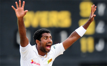 Sri Lankan bowler Dhammika Prasad appeals during the fourth day of the second Test match between Sri Lanka and Pakistan at the P. Sara Oval Cricket Stadium in Colombo on June 27, 2015. (AFP)