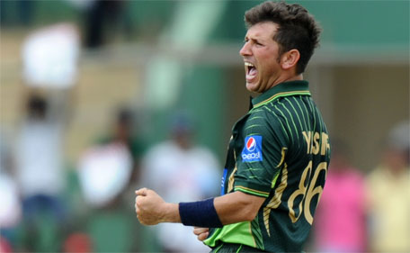 Pakistan bowler Yasir Shah celebrates after he dismissed Sri Lankan cricket captain Angelo Mathews during the first one day international (ODI) cricket match between Sri Lanka and Pakistan at The Rangiri Dambulla International Cricket stadium in Dambulla, on July 11, 2015. (AFP)