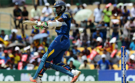Sri Lankan cricketer Dinesh Chandimal plays a shot  during the first one day international (ODI) cricket match between Sri Lanka and Pakistan at The Rangiri Dambulla International Cricket stadium in Dambulla, on July 11, 2015. (AFP)