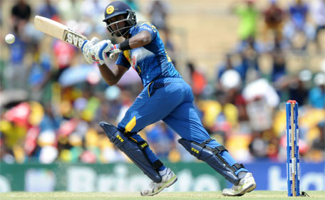 Sri Lankan cricket captain Angelo Mathews plays a shot  during the first one day international (ODI) cricket match between Sri Lanka and Pakistan at The Rangiri Dambulla International Cricket stadium in Dambulla, on July 11, 2015. (AFP)